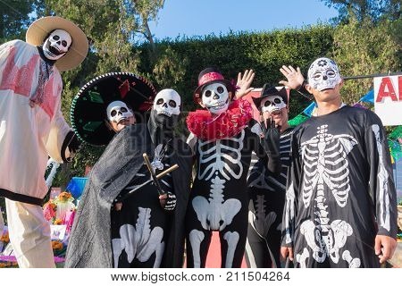 Participants In Traditional Clothing During Day Of The Dead