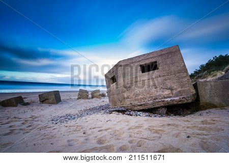 Derelict WW2 concrete anti tank blocks and pillbox on Roseilse beach, Moray, Scotland