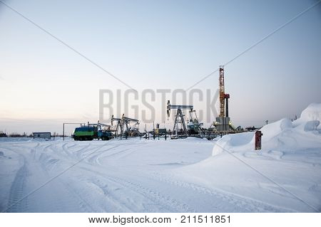 Oil Field. Drilling Rig And Oil Pump.