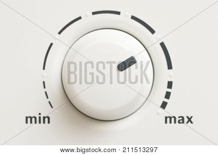 Macro Shot Of A Minimum Maximum Level Control Knob