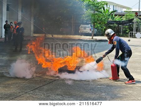 BANGKOK THAILAND - OCTOBER 31 2017 : People preparedness for fire drill and training to use a fire safety tank.