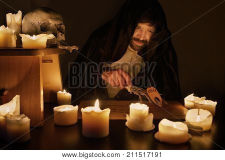 Mysterious session of spiritualist mystic man in hood poster
