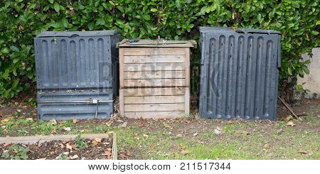 Recycling Kitchen Food Waste In A Home Compost Bin Including Fruit And Vegetable Peelings, Tea Bags