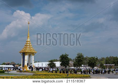 CHIANG MAI, THAILAND - OCTOBER 26: Thai people present Sandalwood flowers as a final tribute to His Majesty The Late King Bhumibol Adulyadej before royal cremation ceremony at Chiang Mai International Exhibition and Convention Centre on October 26 2017