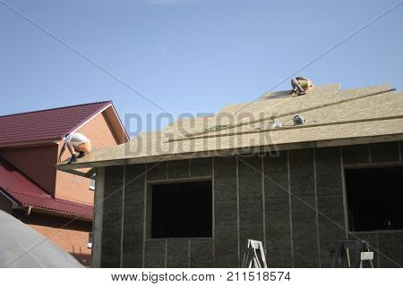 Frame house made of straw. Facade. Roof
