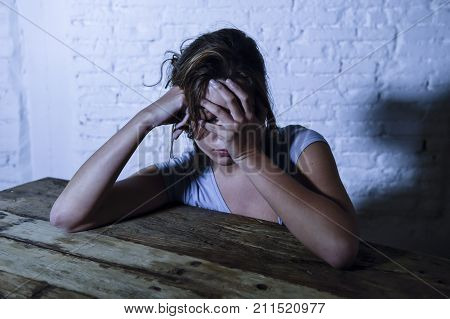 young beautiful sad and depressed woman looking wasted and frustrated suffering pain and depression feeling low and break down lonely and thoughtful at home in sadness emotion concept