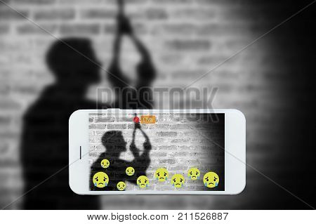 Problem of using social networks with wrong purpose effect concept:silhouette of sad man hanging suicide stream his commits suicide stream live on social media. Crime violence within social networks.