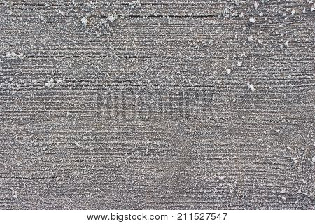 Wooden panel covered with hoar frost closeup view
