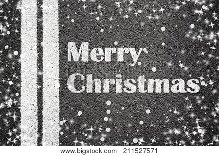 Asphalt texture background with white line and text Merry Christmas