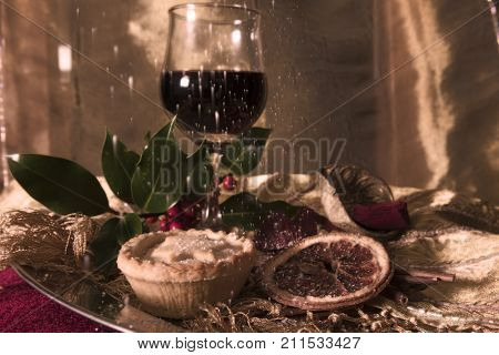 Celebrating Christmas holidays with party food, wine and mince pies on a silver platter