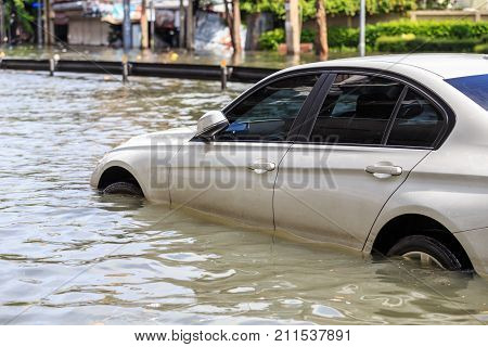 Car Parking On The Street And Show Level Of Water Flooding In Bangkok