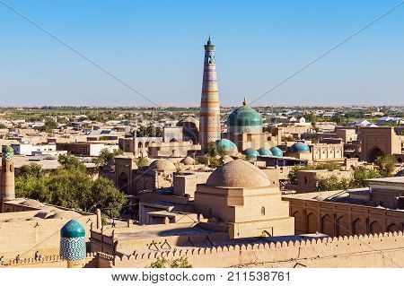 Panoramic view of Islam Khoja Minaret and moque in Itchan Kala, the inner town of the city of Khiva - Uzbekistan