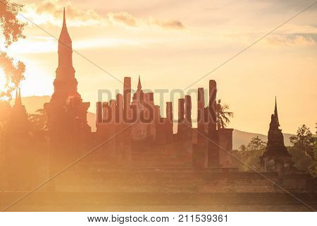 Sukhothai Historical Park At Sunset Time, Sukhothai Province, Located In A Beautiful Setting Of Lawn