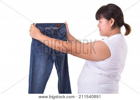 Fat Asian Woman Trying To Wear Small Size Jeans Isolated On White. Fat And Healthcare Concept
