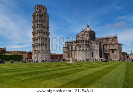 Pisa, Italy - May 24, 2017: Stunning daily view at the Pisa Baptistery, the Pisa Cathedral and the Tower of Pisa. They are located in the Piazza dei Miracoli (Square of Miracles) in Pisa, Italy.
