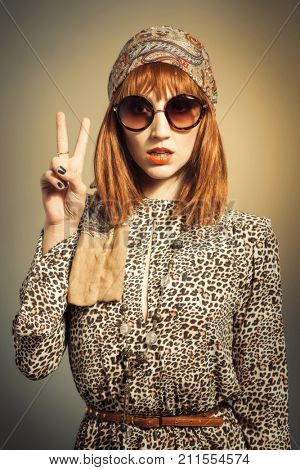 Portrait of a young woman in retro vintage sixties era style clothing  poster