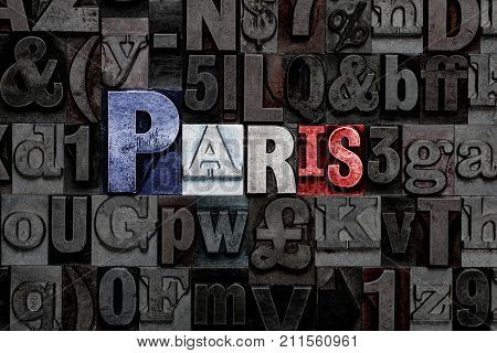 The word Paris made from old metal letterpress letters with the colours of the French flag
