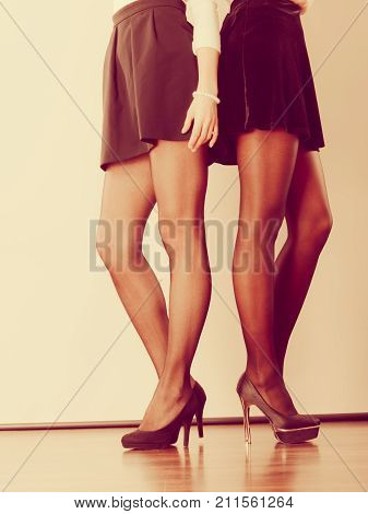 Fashion clothes clothing accessories trendy outfits concept. Two women legs presenting high heels
