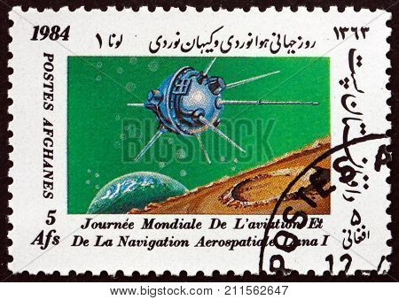 AFGHANISTAN - CIRCA 1984: a stamp printed in Afghanistan shows Luna 1 international day of the space research circa 1984
