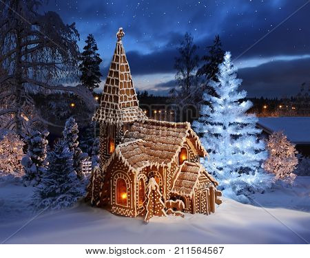 Gingerbread church with lit Christmas tree on Xmas night