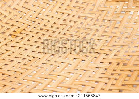 close-up of wooden threshing basket (bamboo) isolated on white background