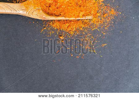 Dried Saffron Spice On Black Background. Raw Organic Pistil Powder Saffron Are Scattered On The Tabl