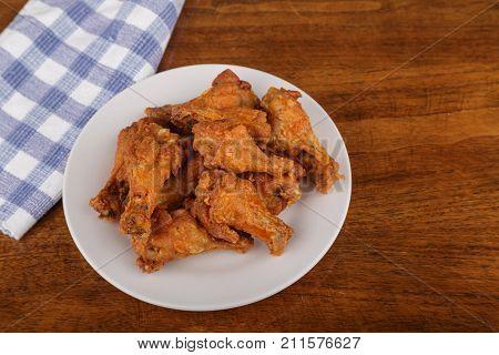 Crispy buffalo chicken wings on a white plate