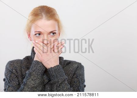 Shocked woman looking worried cant believie in bad news covering lips with hands