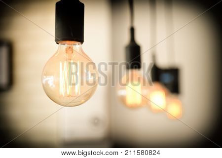 light bulbs against wall background.retro luxury light lamp glowing.Restaurant modern interior light bulbs