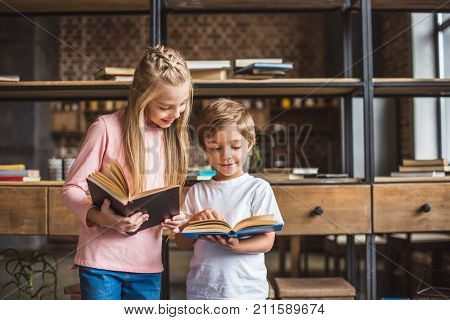Smiling Siblings With Books