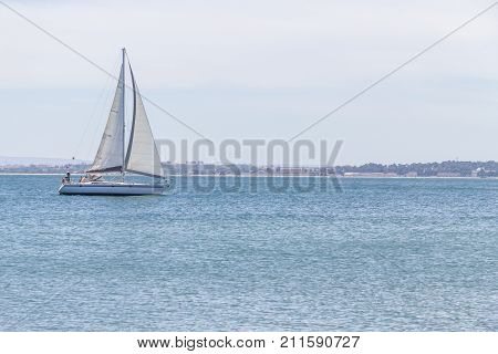 Sailboat navigating in Tejo River Lisboa Portugal