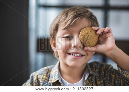 Smiling Little Boy With Cookie