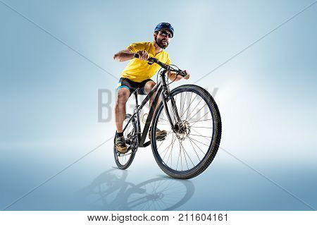 The male bicyclist on gray, studio shot. poster