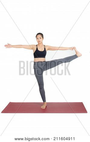 young asian woman doing yoga in Utthita Hasta Padangustasana or Extended Hand-to-Big-Toe pose on the mat isolated on white background exercise fitness sport training and healthy lifestyle concept