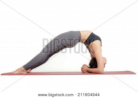 young asian woman doing yoga in Dwi Pada Viparita Dandasana or Two-Legged Inverted Staff pose on the mat isolated on white background exercise fitness sport training and healthy lifestyle concept