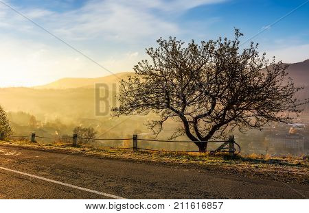 Road Through Mountainous Countryside At Sunrise