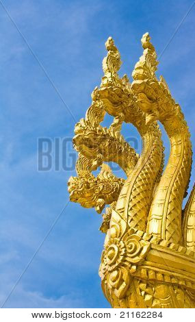 Head Of Golden Naga In Blue Sky