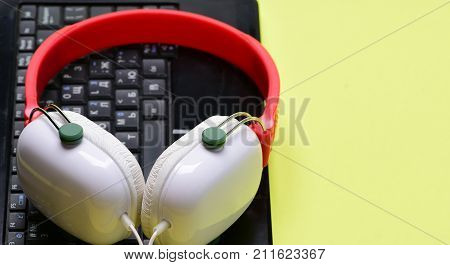 Music And Digital Equipment Concept. Electronics On Light Yellow Background