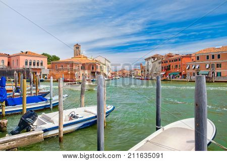 Old houses and boats at the canals ot the island of Murano near Venice