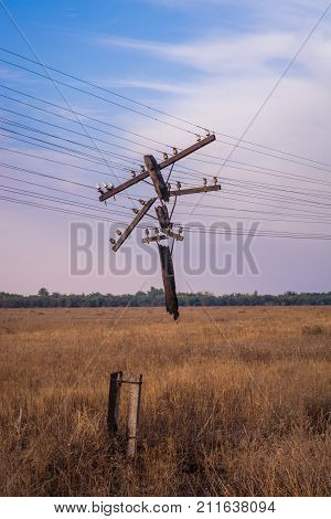 Destroyed power line. Power line. Old power line