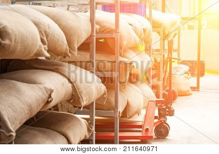Bags In The Warehouse On The Racks. Coffee, Arabica, Rice