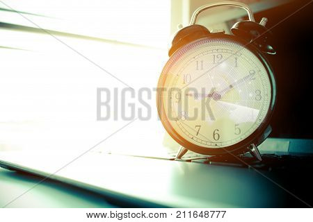 Alarm clock with Radar background on computer. Concept of abroad international Educational times Studies lead to success in life Time is Education.