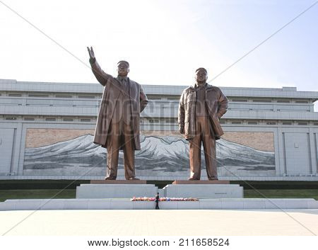 PYONGYANG, NORTH KOREA (DPRK) - SEPTEMBER 14, 2017: Grand Monument Mansudae. Statues of Great Leaders Kim Il Sung and Kim Jong Il against a background of mosaic with a sacred mountain Paektusan