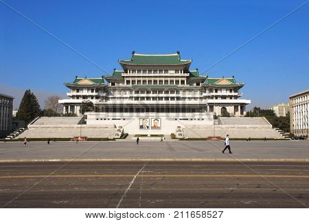 NORTH KOREA, PYONGYANG - SEPTEMBER 20, 2017: Great People's Study House with of portraits of two presidents DPRK, Kim Il Sung Square, capital of North Korea