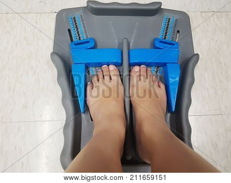 Foot measure tool - feet of customer in measure shoe size in retail footwear stores to measure accurately foot sizes on the floor. Made of plastic with simple functional.