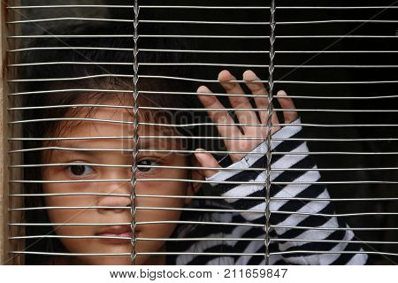 Asian girl children in the cage Human trafficking concept