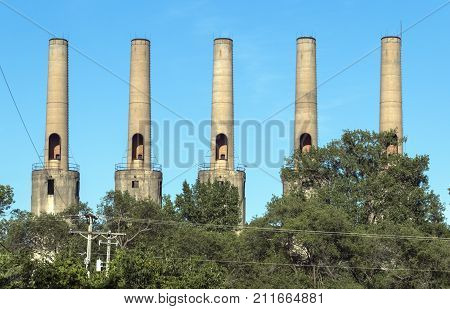 ROSEMOUNT MN/USA - JULY 26 2016 - The five smokestacks at the Gopher Ordnance Works a WW II-era munitions plant in Rosemount. Photo taken July 26 2016.