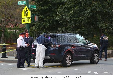 NEW YORK - OCTOBER 31, 2017: NYPD investigators are at the crime scene near a terror attack site in lower Manhattan in New York.