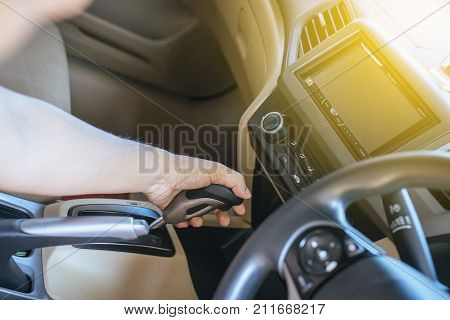 Hands man holding on automatic gear shift ,Driving a car