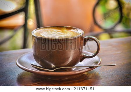 Cup Of Coffee And Foam In Morning Day